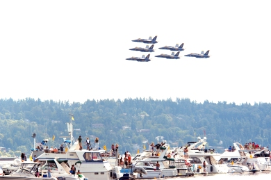 040807-N-6477M-045 Seattle, Wash. (Aug. 7, 2004) Ñ The Blue Angels perform above Lake Washington during Seafair week in Seattle, Wash. Seafair events include the Torchlight Parade, the Blue Angels show, amateur athletics, boat racing and Naval and Coast Guard ship tours. U.S. Navy photo by PhotographerÕs Mate 2nd Class Eli J. Medellin (RELEASED)